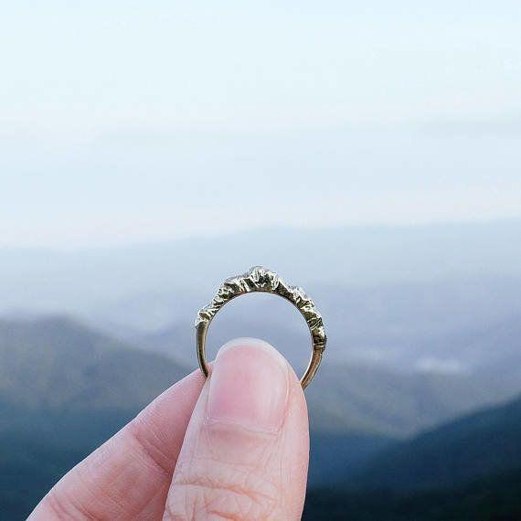 """For the traveler who's an adventurer at heart. <strong><a href=""""https://www.etsy.com/listing/103718780/silver-mountain-ring-mountain-jewelry?ref=holiday-gift-guide"""" target=""""_blank"""" rel=""""noopener noreferrer"""">Get it here</a></strong><a href=""""https://www.etsy.com/listing/103718780/silver-mountain-ring-mountain-jewelry?ref=holiday-gift-guide"""" target=""""_blank"""" rel=""""noopener noreferrer""""></a>."""