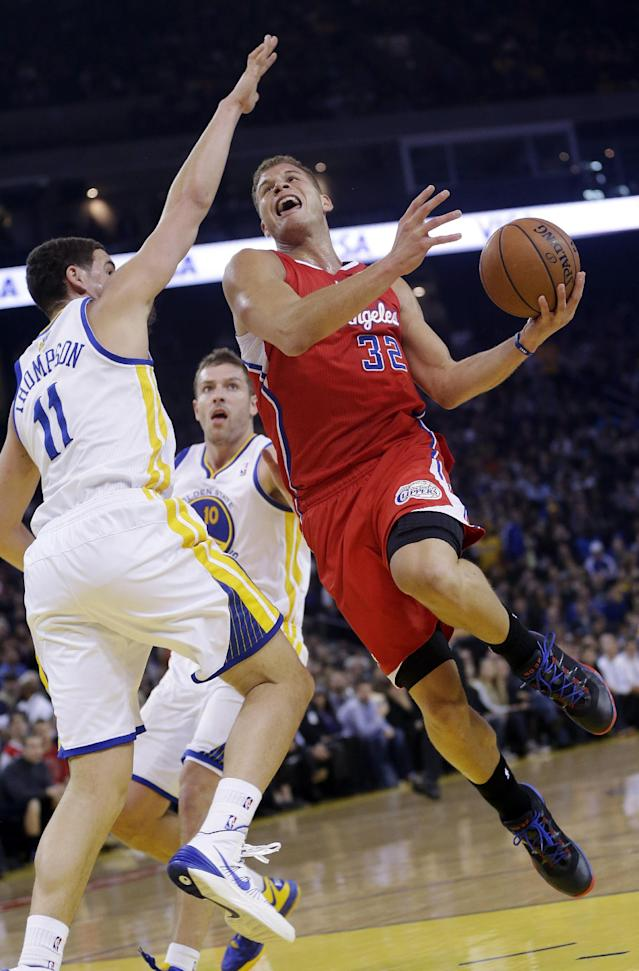 Los Angeles Clippers' Blake Griffin (32) goes up for a shot next to Golden State Warriors' Klay Thompson (11) during the first half of an NBA basketball game Thursday, Jan. 30, 2014, in Oakland, Calif. (AP Photo)