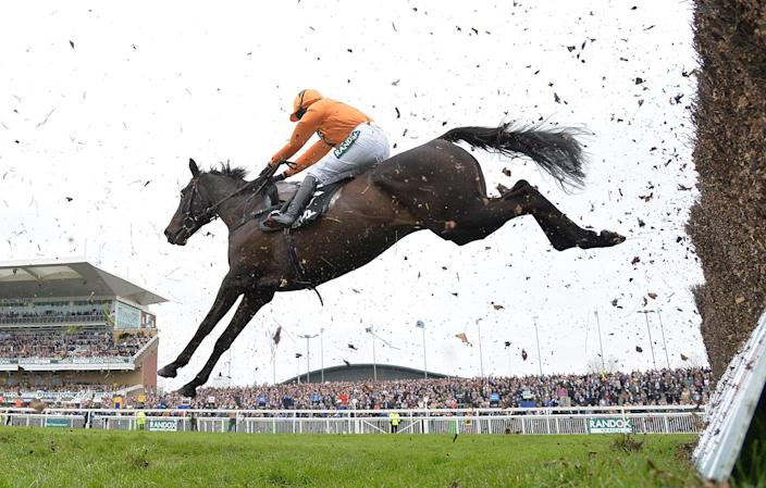 <p>Tea For Two and jockey, Lizzie Kelly take the last fence before going on to win The Betway BowlSteeple Chase on the first day of The Grand National meeting at Aintree Racecourse, Aintree, United Kingdom on April 6, 2017. (Photo: Rex Shutterstock via ZUMA Press) </p>