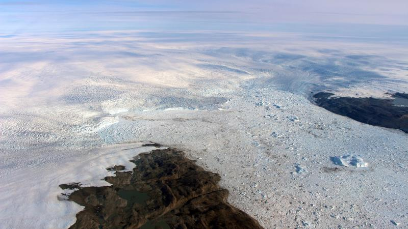 This 2016 photo provided by NASA shows patches of bare land at the Jakobshavn glacier in Greenland. The major Greenland glacier that was one of the fastest shrinking ice and snow masses on Earth is growing again, a new NASA study finds. The Jakobshavn glacier around 2012 was retreating about 1.8 miles (3 kilometers) and thinning nearly 130 feet (almost 40 meters) annually. But the last two years it started growing again at about the same rate, according to a study released on Monday, March 25, 2019, in Nature Geoscience. Study authors and outside scientists think this is temporary.  (NASA via AP)