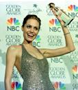 """After Angelina Jolie won a Golden Globe for Best Actress in a TV Movie for her role in """"Gia"""" in 1999 (she is seen here with the award), she jumped into the pool at the Beverly Hilton"""