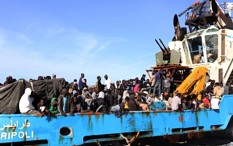 A Libyan coastguard boat carrying around 500 mostly African migrants arrive at the port in the city of Misrata on May 3, 2015, after the coastguard intercepted five boats carrying people trying to reach Europe (AFP Photo/Mahmud Turkia)