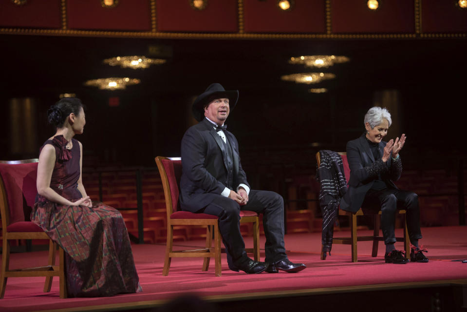Country singer-songwriter Garth Brooks, speaks during a press event with violinist Midori, left, and singer-songwriter and activist Joan Baez, during the 43nd Annual Kennedy Center Honors at The Kennedy Center on Friday, May 21, 2021, in Washington. (AP Photo/Kevin Wolf)
