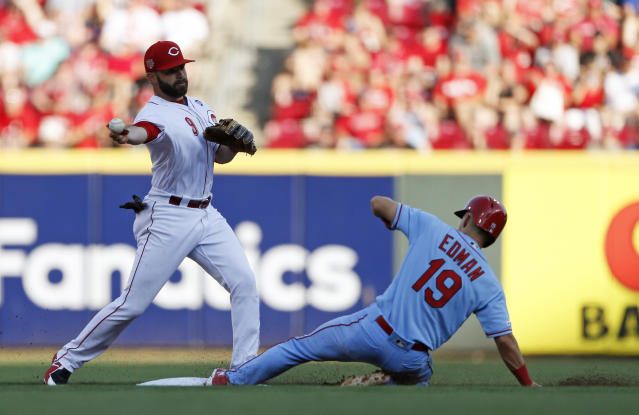 St. Louis Cardinals' Tommy Edman (19) is forced out at second base on a double play ball off the bat of Paul Goldschmidt as Cincinnati Reds second baseman Jose Peraza, left, throws to first during the first inning of a baseball game, Saturday, July 20, 2019, in Cincinnati. (AP Photo/Gary Landers)