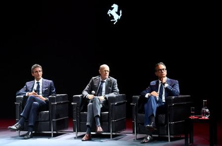 Ferrari's Chief Marketing and Commercial Officer Enrico Galliera, Chief Technology Officer Michael Hugo Leiters and Chief Design Officer Flavio Manzoni attend a press conference after presenting two new Ferrari models at company's headquarters in Maranello