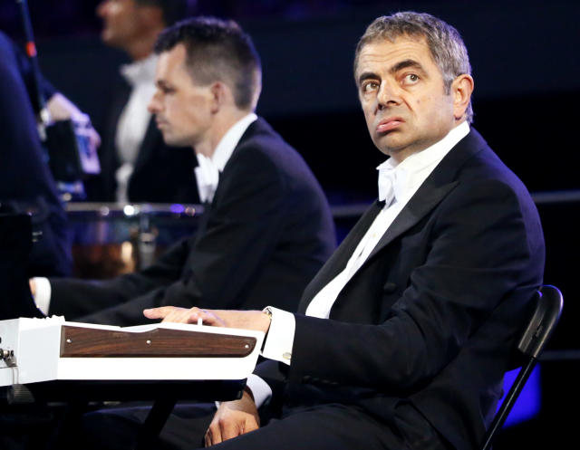 Actor Rowan Atkinson, known for his role as Mr Bean, performs during the opening ceremony of the London 2012 Olympic Games at the Olympic Stadium July 27, 2012. REUTERS/Kai Pfaffenbach (BRITAIN - Tags: SPORT OLYMPICS ENTERTAINMENT TPX IMAGES OF THE DAY)