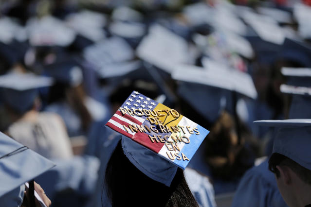 "<p>A graduate displays a hat reading ""Producto de Inmigrantes – Hecho en USA"" during the Columbia University graduation ceremony in New York, May 17, 2017. Over 14,000 students graduated during the ceremonies. (Photo:Seth Wenig/AP) </p>"
