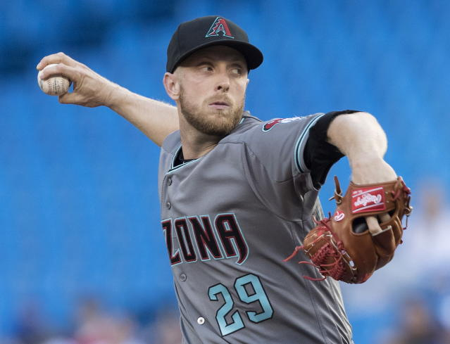 Arizona Diamondbacks starting pitcher Merrill Kelly throws against the Toronto Blue Jays in a baseball game Friday, June 7, 2019, in Toronto. (Fred Thornhill/The Canadian Press via AP)