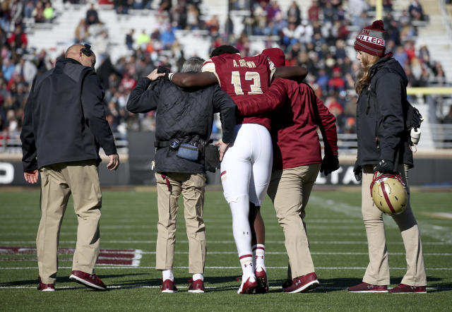 "Boston College quarterback <a class=""link rapid-noclick-resp"" href=""/nfl/players/29423/"" data-ylk=""slk:Anthony Brown"">Anthony Brown</a> is helped off the field after getting injured against North Carolina State Saturday, Nov. 11, 2017, in Boston. (AP Photo/Mary Schwalm)"