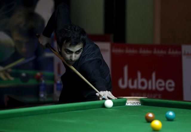 India's Pankaj Advani plays a shot during his snooker match against China's Li Yingdong during the IBSF 6 Reds Snooker Championships in Karachi August 7, 2015. REUTERS/Akhtar Soomro