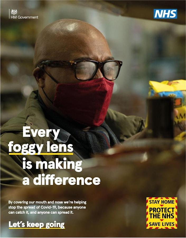 Britons are urged to keep staying at home in a new campaign. This poster reads: 'every foggy lens is making a difference', and features a man with steamed up glasses wearing a face mask - News Scans
