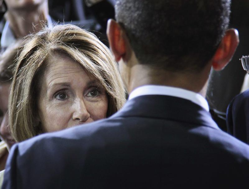 President Barack Obama speaks with House Minority Leader Nancy Pelosi of Calif.,  at the Washington Convention Center in Washington, Friday, July 29, 2011, after delivering remarks on improved Fuel Efficiency Standards for cars and light trucks. (AP Photo/Pablo Martinez Monsivais)
