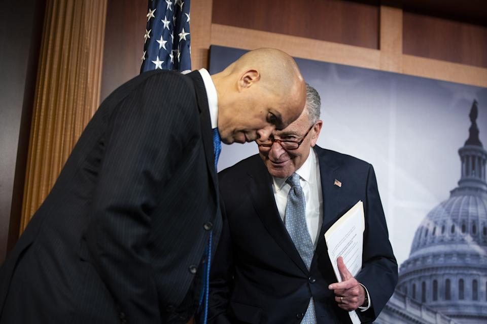 Chuck Schumer, right, with Cory Booker