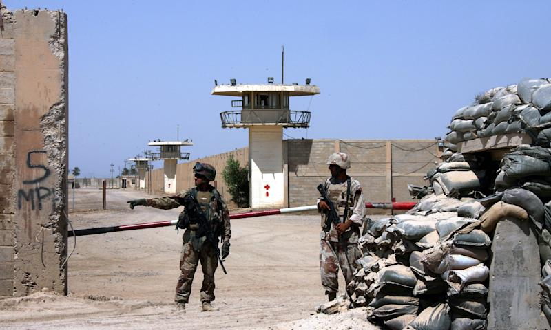FILE - In this Sept. 2, 2006, file photo, Iraqi army soldiers stand guard at the Abu Ghraib prison on the outskirts of Baghdad, Iraq. Al-Qaida's branch in Iraq claimed responsibility Tuesday for audacious raids on two high-security prisons on the outskirts of Baghdad this week that killed dozens and set free hundreds of inmates, including some of its followers. (AP Photo/Khalid Mohammed, File)