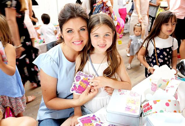 <p>The <i>Saved by the Bell</i> alum and her cute 7-year-old daughter, Harper, got crafty, decorating lunch boxes at a Num Noms event the actress hosted at Au Fudge in West Hollywood. The guest list included Thiessen's former co-stars Mario Lopez and Ian Ziering. (Photo: Rachel Murray/Getty Images for Num Noms) </p>
