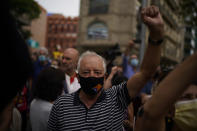 People take part in a protest outside the Italian consulate in support of former Catalan leader Carles Puigdemont in Barcelona, Spain, Friday, Sept. 24, 2021. Puigdemont, who fled Spain after a failed secession bid for the northeastern region in 2017, was detained Thursday in Sardinia, Italy, his lawyer said. Puigdemont, who lives in Belgium and now holds a seat in the European Parliament, has been fighting extradition to Spain, which accused him and other Catalan independence leaders of sedition. (AP Photo/Joan Mateu)