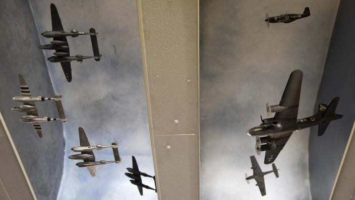In this photo taken on Thursday, Nov. 7, 2019, a collection of World War II planes hang from the ceiling at the Remember Museum 39-45 in Thimister-Clermont, Belgium. The museum houses countless World War II objects, but it's most important collection are stories and photos of those who served in World War II, mostly during the Battle of the Bulge. Veterans of the WWII Battle of the Bulge are heading back to mark, perhaps the greatest battle in U.S. military history, when 75-years ago Hitler launched a desperate attack deep through the front lines in Belgium and Luxembourg to be thwarted by U.S. forces.(AP Photo/Virginia Mayo)