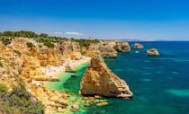 <p>Considered by the Michelin Guide as one of the 10 most beautiful beaches in Europe and as one of the 100 most beautiful beaches in the world, it's not hard to see why people flock to Praia De Marinha. </p>