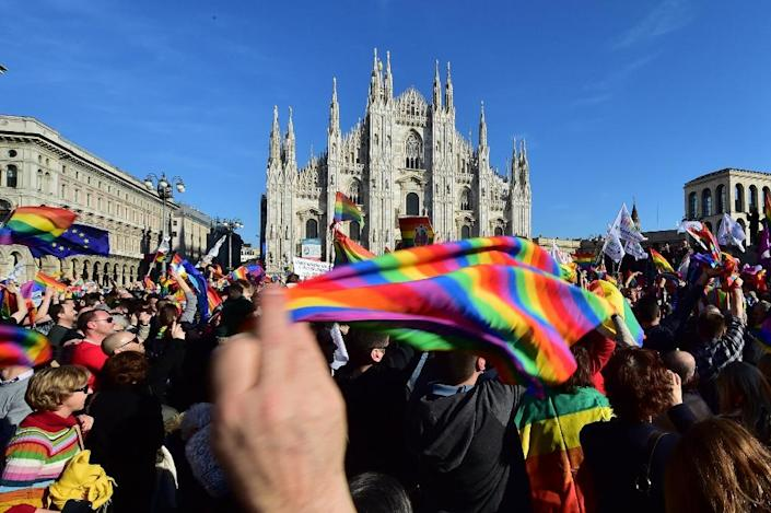 """Supporters of the bill """"Cirinna"""" that would allow gay civil unions, currently with the Italian Senate, demonstrate on February 21, 2016 at Piazza Duomo in Milan (AFP Photo/Giuseppe Cacace)"""