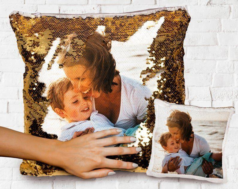 """Pick the photo and color for this personalized sequin pillow. Perfect for friends, family and partners.&nbsp;<a href=""""https://fave.co/30jPeJT"""" target=""""_blank"""" rel=""""noopener noreferrer"""">Find it for $25 on Etsy</a>."""