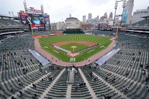 PHOTO: Baseball fans watch the opening ceremony of the Detroit Tigers and Cleveland Indians baseball game at Comerica Park in Detroit, April 1, 2021. (Carlos Osorio/AP)
