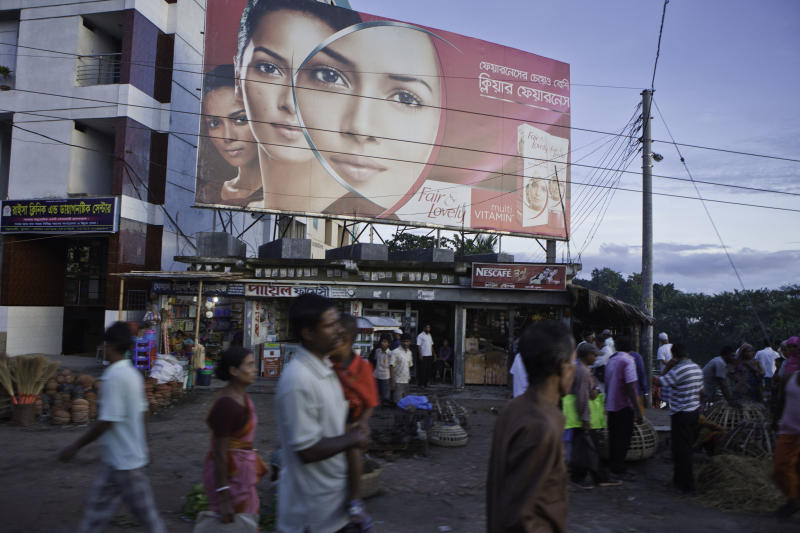 A large billboard advertising skin lightening cream in Jessore, Bangladesh.  (Andrew Aitchison via Getty Images)