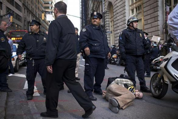 "Austin Guest, an Occupy Wall Street protestor, is arrested during a ""Spring Training"" march through the streets of the Financial District in New York April 6, 2012. Organizers say the training exercise is meant to teach people how to protest, avoid law enforcement and stay safe."