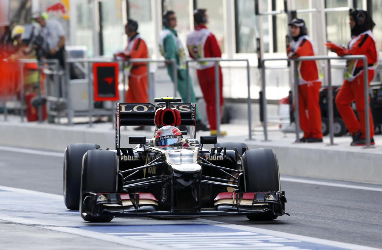 Lotus F1 Formula One driver Romain Grosjean of France drives in the pit lane during the third practice session of the Abu Dhabi F1 Grand Prix at the Yas Marina circuit on Yas Island, November 2, 2013. REUTERS/Ahmed Jadallah (UNITED ARAB EMIRATES - Tags: SPORT MOTORSPORT F1)