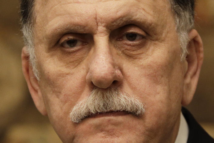 Libya's Prime Minister Fayez al-Sarraj holds a press conference after his meeting with Italian Premier Giuseppe Conte at Chigi palace, in Rome, Saturday, Jan. 11, 2020. (AP Photo/Gregorio Borgia)