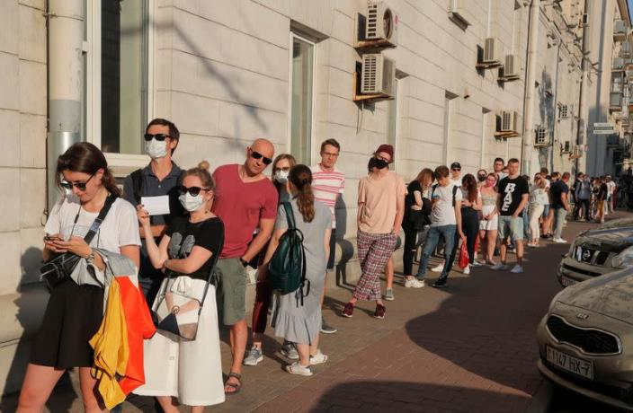 People queue to visit a souvenir and gift shop in Minsk