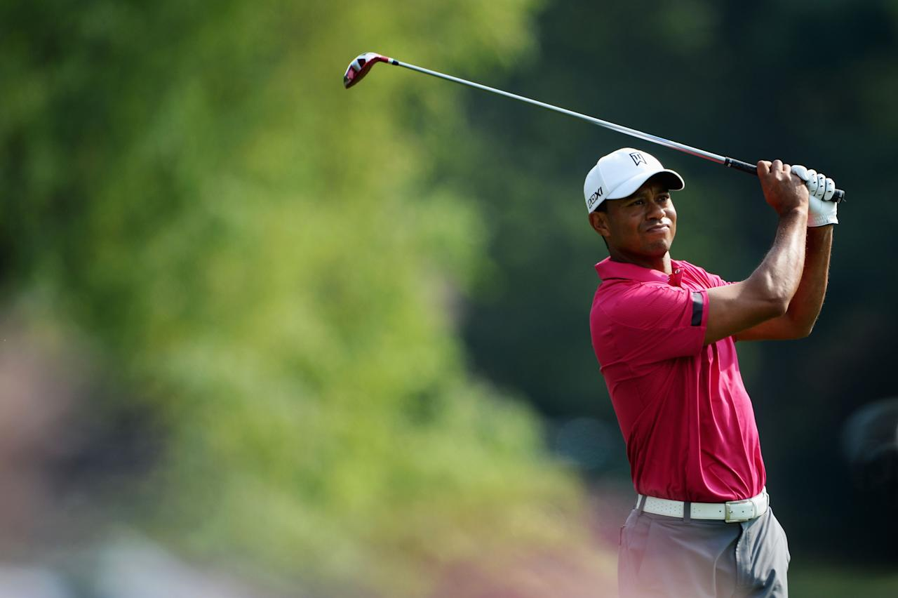 ROCHESTER, NY - AUGUST 07: Tiger Woods of the United States hits a shot during a practice round prior to the start of the 95th PGA Championship at Oak Hill Country Club on August 7, 2013 in Rochester, New York. (Photo by Stuart Franklin/Getty Images)