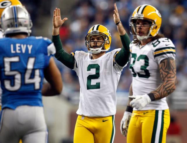 Green Bay Packers kicker Crosby raises his arms after his field goal against the Detroit Lions during the second half of their NFL football game in Detroit