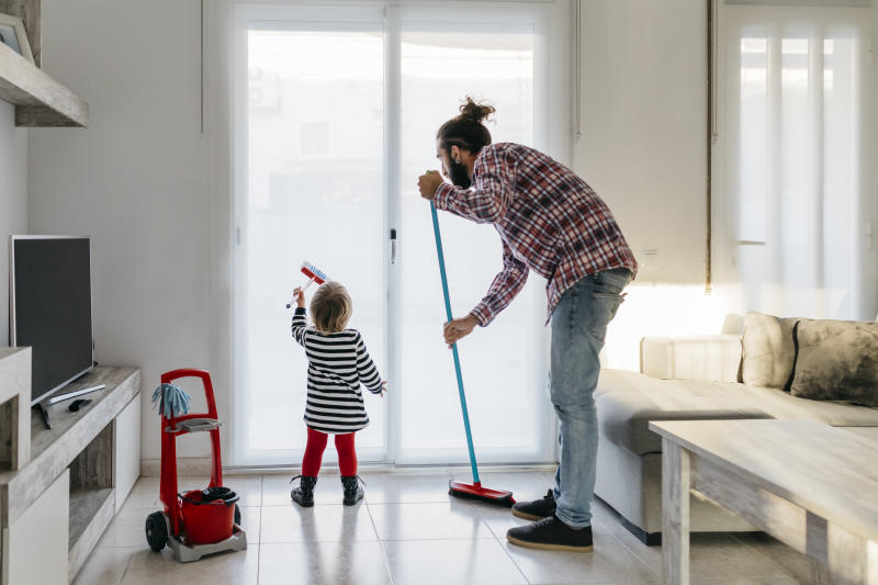 Doing your fair share of cleaning is a hallmark of a modern man. (Getty Images)