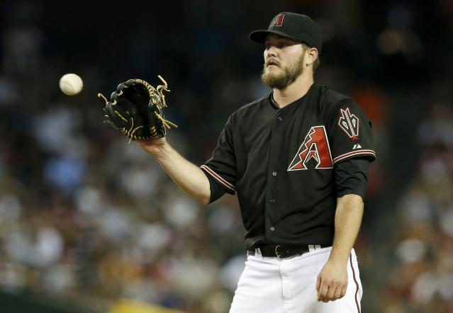 Arizona Diamondbacks' Wade Miley gets the ball back as he pitches against the Atlanta Braves during the fifth inning of a baseball game Saturday, June 7, 2014, in Phoenix. (AP Photo/Ross D. Franklin)