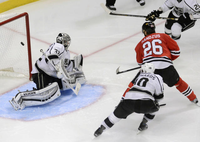 Chicago Blackhawks center Michal Handzus (26) scores the game-winning goal to defeat the Los Angeles Kings 5-4 in the second overtime period in Game 5 of the Western Conference finals in the NHL hockey Stanley Cup playoffs on Wednesday, May 28, 2014, in Chicago. (AP Photo/Daily Herald, Bob Chwedyk)