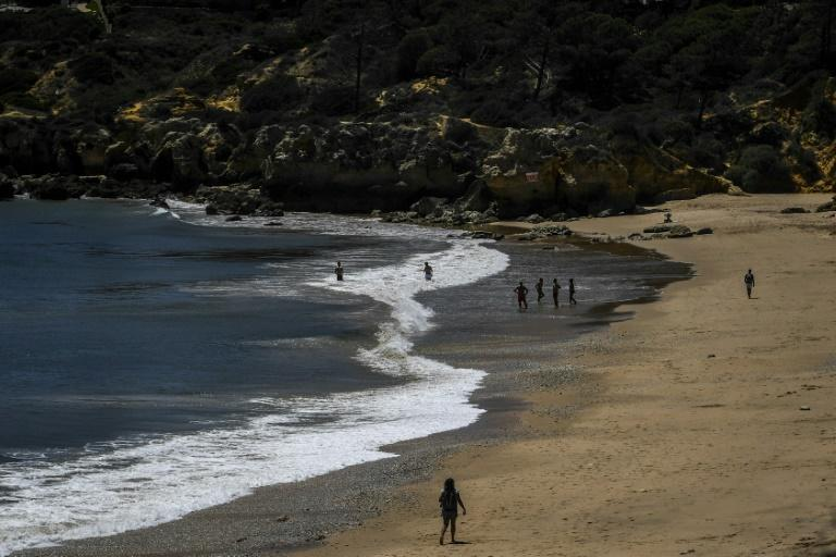 Only around 20 people took advantage of the warm sun and waters at Oura beach in the Algarve