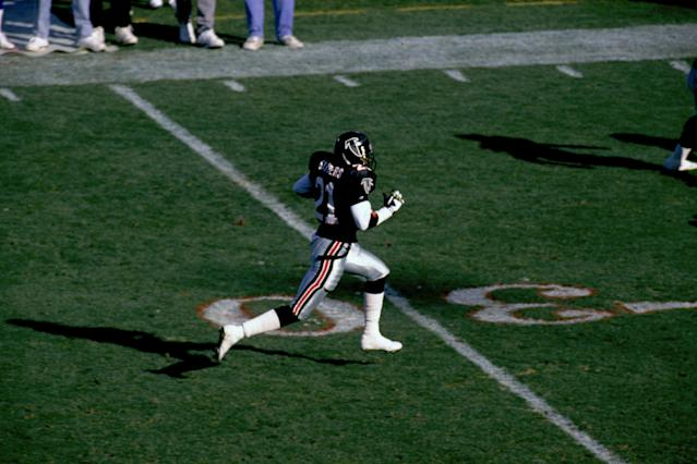 The pants were a bit much, but that jersey looked great, especially on this interception return by Deion Sanders. (Photo by Gin Ellis/Getty Images)
