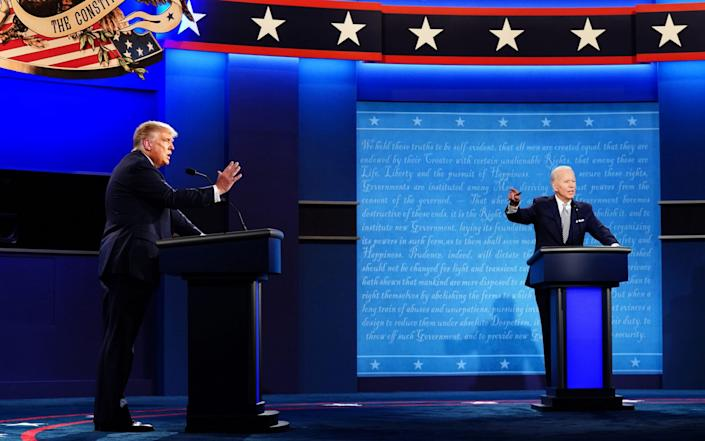 US President Donald J. Trump (L) and Democratic presidential candidate Joe Biden (R) spar during the first 2020 presidential election debate at Samson Pavilion in Cleveland, Ohio, USA, 29 September 2020 - JIM LO SCALZO/EPA-EFE/Shutterstock
