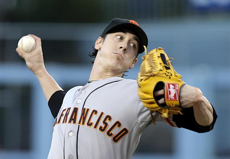 File - In this Sept. 14, 2013 file photo, San Francisco Giants starter Tim Lincecum pitches to the Los Angeles Dodgers in the first inning of a baseball game in Los Angeles.  Lincecum is staying put with the Giants just as he hoped, reaching agreement Tuesday, OCt. 22, 2013, on a $35 million, two-year contract through the 2015 season.  The deal is pending a physical, which hadn't been set