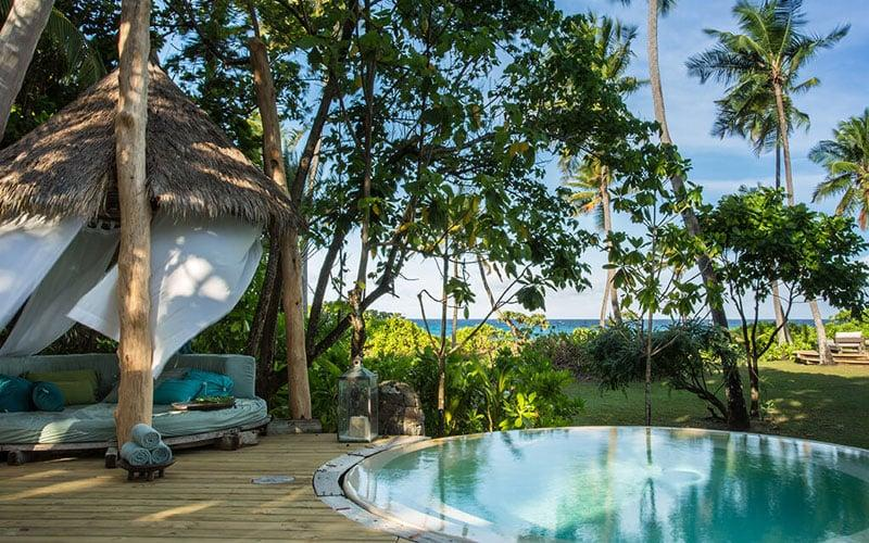 Activities at Seychelles' North Island include impromptu yoga sessions under the takamaka trees - for visitors that can pull themselves away from their circular plunge pools