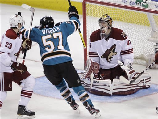 San Jose Sharks right wing Tommy Wingels (57) celebrates after left wing Daniel Winnik, not shown, scores past Phoenix Coyotes goalie Mike Smith (41) in the second period of an NHL hockey game in San Jose, Calif., Saturday, March 24, 2012. (AP Photo/Paul Sakuma)