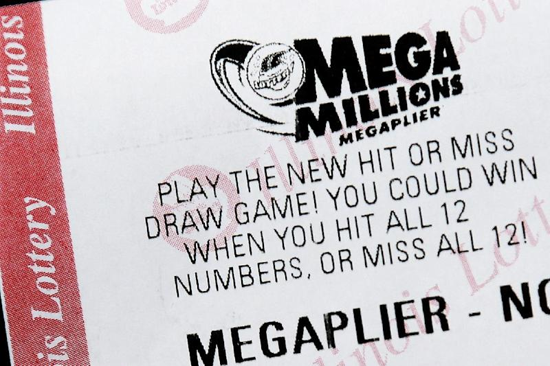 A Mega Millions lottery ticket is displayed on Friday, Dec. 13, 2013, in Springfield, Ill. Superstition didn't deter players hoping that Friday the 13th would bring them good luck in the recently revamped Mega Millions game, as heavy sales prompted lottery officials to boost the jackpot from $400 million to $425 million for Friday's drawing. (AP Photo/Seth Perlman)