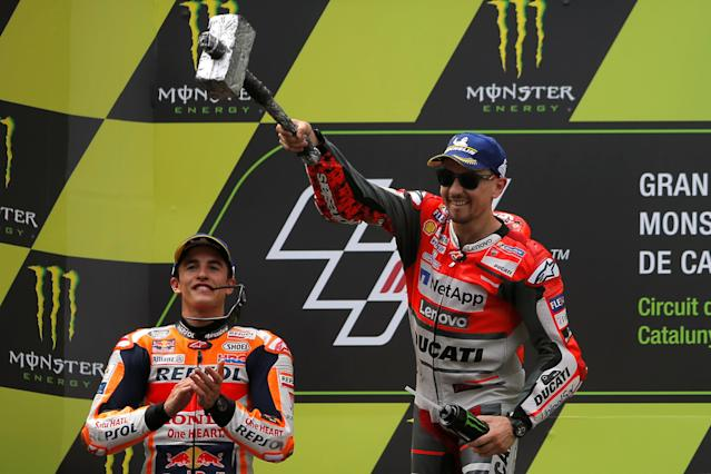 MotoGP - Grand Prix of Catalunya - Circuit de Barcelona-Catalunya, Barcelona, Spain - June 17, 2018 Ducati Team's Jorge Lorenzo celebrates after winning the race with second placed Repsol Honda Team's Marc Marquez REUTERS/Jon Nazca