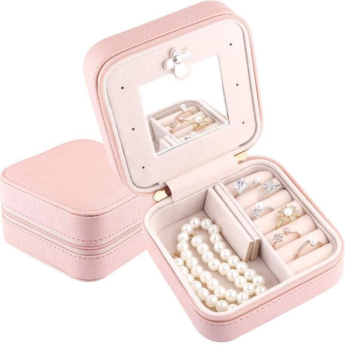 """<a href=""""https://amzn.to/2RKOmf0"""" rel=""""nofollow noopener"""" target=""""_blank"""" data-ylk=""""slk:A travel jewelry box"""" class=""""link rapid-noclick-resp"""">A travel jewelry box</a>, for everyone who likes to accessorize their outfits while away, but complains about spending an hour unraveling tangled necklaces or trying to find errant rings in the bottom of a suitcase. <a href=""""https://amzn.to/2RKOmf0"""" rel=""""nofollow noopener"""" target=""""_blank"""" data-ylk=""""slk:Get it from Amazon"""" class=""""link rapid-noclick-resp"""">Get it from Amazon</a>."""
