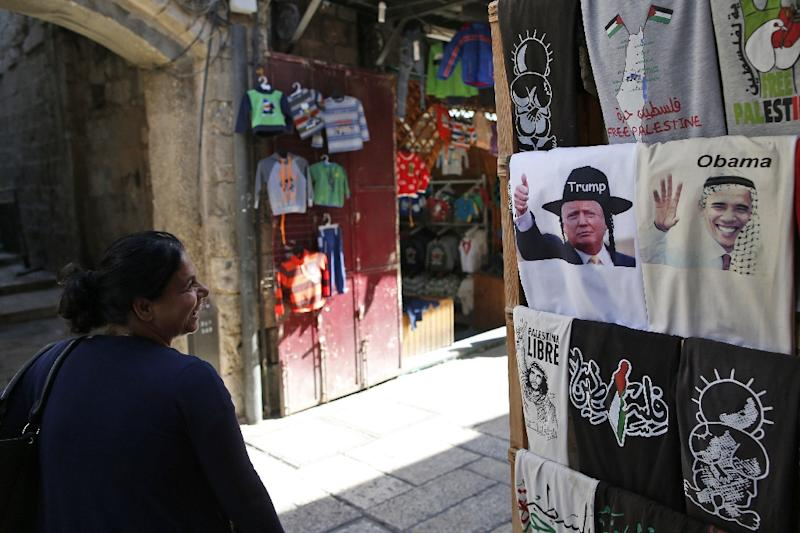 A Jerusalem souvenir shop display T-shirts bearing images of US President Barack Obama (R) wearing a kaffiyeh and president-elect Donald Trump (C) dressed as a Hasidic Jew (AFP Photo/Ahmad Gharabli)