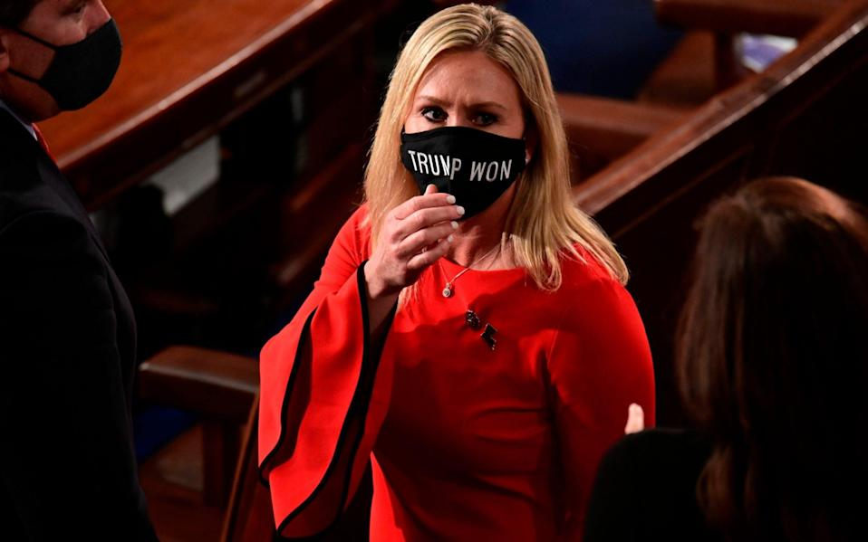 "Republican Marjorie Taylor Greene wearing a ""Trump Won"" face mask on January 3 - Erin Scott /Pool Reuters"