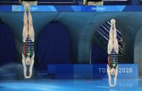 Lena Hentschel and Tina Punzel of Germany compete during the Women's Synchronized 3m Springboard Final at the Tokyo Aquatics Centre at the 2020 Summer Olympics, Sunday, July 25, 2021, in Tokyo, Japan. (AP Photo/Dmitri Lovetsky)