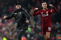 Liverpool manager Jurgen Klopp (left) and captain Jordan Henderson (right) celebrate a thrilling 4-3 win over Crystal Palace (AFP Photo/Paul ELLIS)