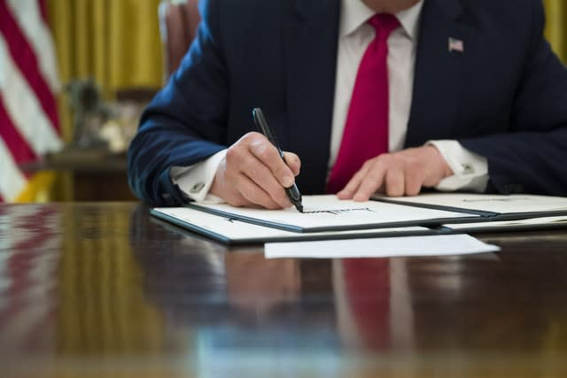 Mr Trump signs an executive order to increase sanctions on Iran