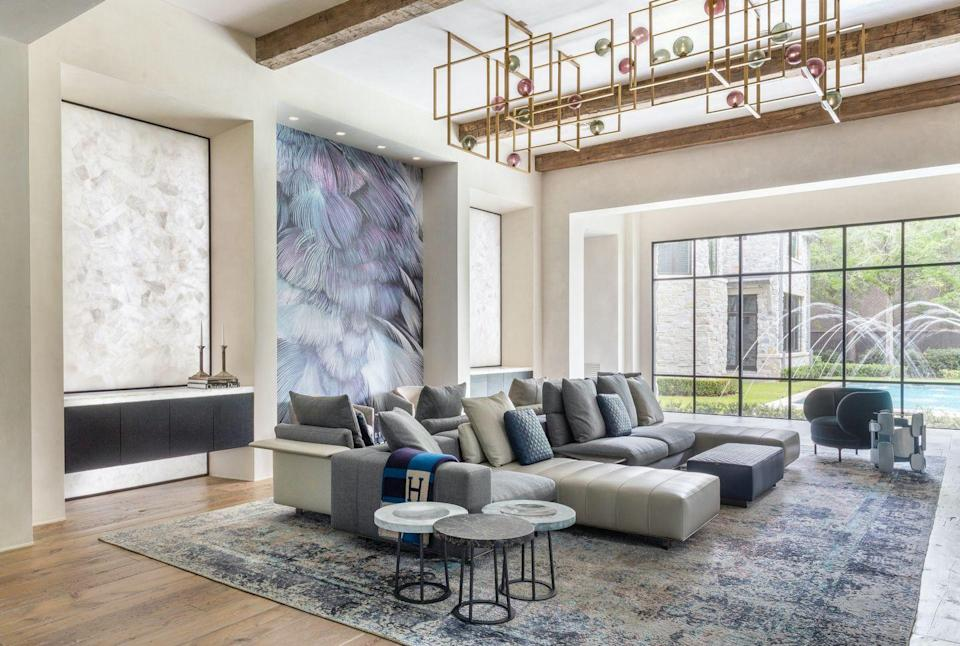 """<p>As this living room from<a href=""""https://contourinteriordesign.com/"""" rel=""""nofollow noopener"""" target=""""_blank"""" data-ylk=""""slk:Contour Interior Design by Nina Magon"""" class=""""link rapid-noclick-resp""""> Contour Interior Design by Nina Magon</a> proves, a wallpapered accent wall can have the same effect as a large-scale piece of art.</p><p><em>Best Fronds Wallpaper, $58<br></em><a class=""""link rapid-noclick-resp"""" href=""""https://www.wallshoppe.com/products/best-fronds-cadet-blue"""" rel=""""nofollow noopener"""" target=""""_blank"""" data-ylk=""""slk:Shop the Look"""">Shop the Look</a><br></p>"""